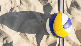 flat-lay-of-volleyball-on-the-beach-sand.jpeg